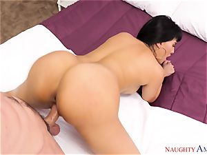 Mercedes Carrera blowing on a thick wood
