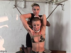 Kathia Nobili and C J babe strapping of forearms
