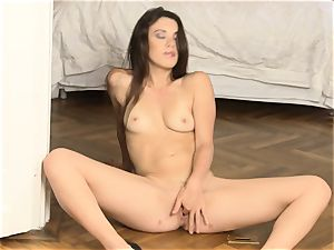 Tiffany nymph finger-tickling her hot vag hole on the floor
