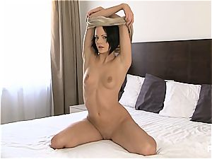 beautiful gal masturbating on her bed