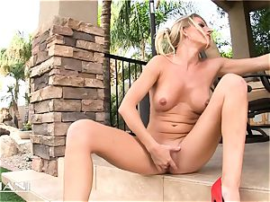mischievous milf sits on fake penis outdoors