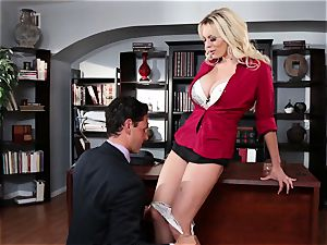Stormy Daniels dicked across an office desk