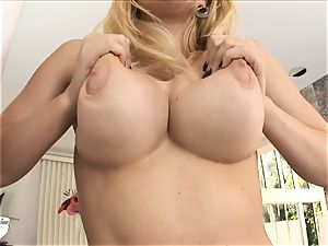 blonde honey Kagney Karter plays with her meaty tits