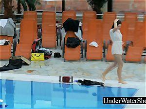 wonderful sandy-haired in the white sundress underwater