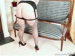 curvy blond wanks in grey nylons and high high-heeled shoes